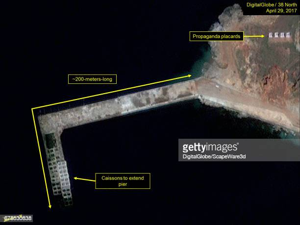 Figure 5 Construction of a new Lshaped pier continues Mandatory credit for all images DigitalGlobe/38 North via Getty Images