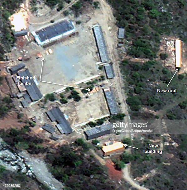 Figure 6b An old building has been reroofed and a new building has been erected at the Main Support Area at the Punggyeri Nuclear Test Site in North...