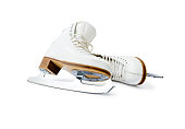 Pair of professional skates for figure ice skating leaning each other close up isolated on white background.
