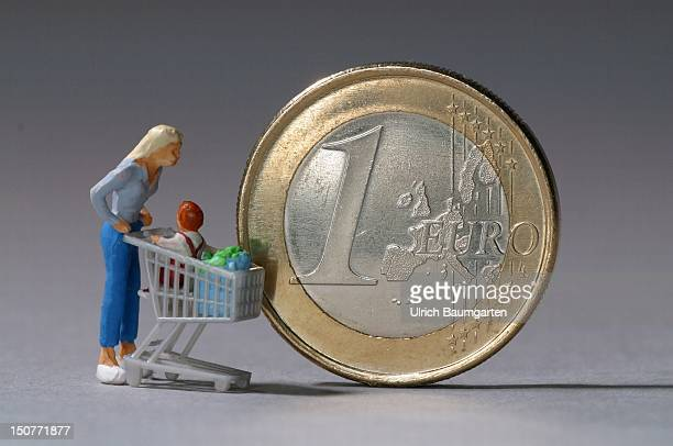 GERMANY BONN Figure next to one Euro coin