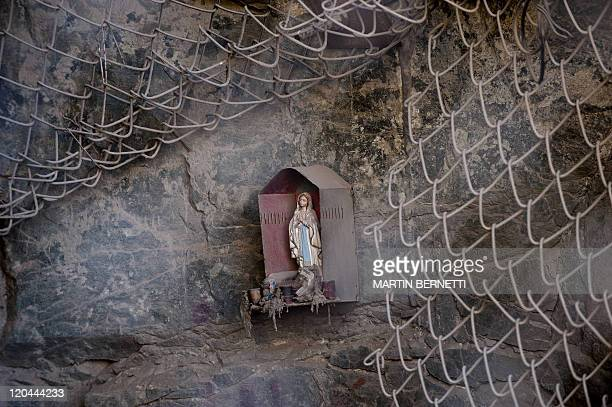 A figure of a Virgin is seen in the entrance of the collapsed San Jose mine near Copiapo 700km north of Santiago on August 4 2011 Next August 5 marks...