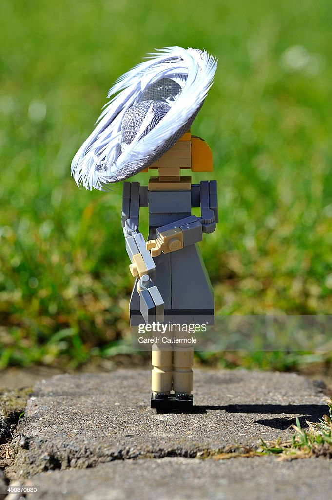 A LEGO figure of <a gi-track='captionPersonalityLinkClicked' href=/galleries/search?phrase=Camilla+-+Duchess+of+Cornwall&family=editorial&specificpeople=158157 ng-click='$event.stopPropagation()'>Camilla</a>, Duchess of Cornwall stands outside a LEGO Buckingham Palace wearing a designer hat by Rachel Trevor-Morgan, The Queen's milliner ahead of Royal Ascot at LEGOLAND Windsor on June 10, 2014 in Windsor, England.