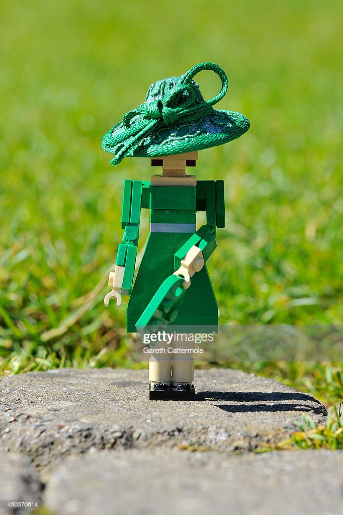 A LEGO figure of Carole Middleton stands outside a LEGO Buckingham Palace wearing a designer hat by Rachel Trevor-Morgan, The Queen's milliner ahead of Royal Ascot at LEGOLAND Windsor on June 10, 2014 in Windsor, England.
