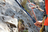 Figure of eight: Rock climber holding the rope; Shallow depth of field; France; Languedoc Roussillon
