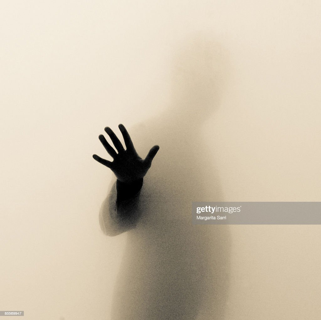 Figure of man behind bright screen : Stock Photo