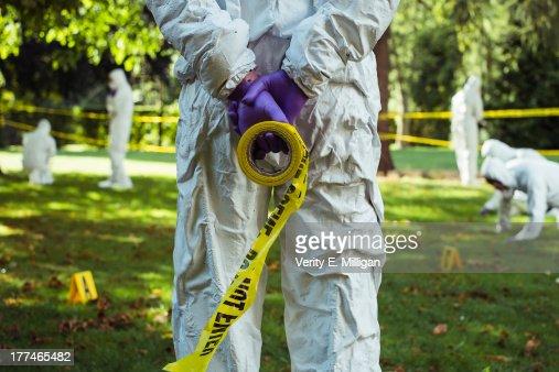 Figure of man presiding over forensic scene
