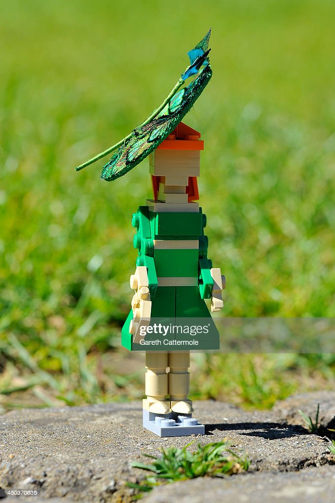 A LEGO figure of Princess Beatrice stands outside a LEGO Buckingham Palace wearing a designer hat by Rachel Trevor-Morgan, The Queen's milliner ahead of Royal Ascot at LEGOLAND Windsor on June 10, 2014 in Windsor, England.