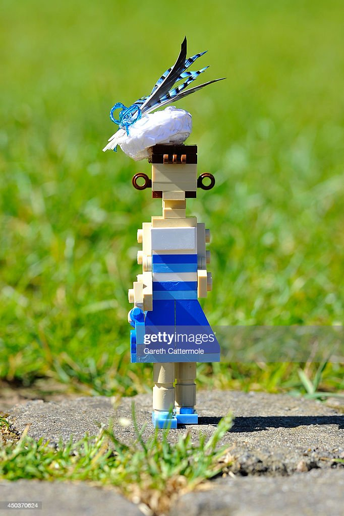 A LEGO figure of Princess Eugenie stands outside a LEGO Buckingham Palace wearing a designer hat by Rachel Trevor-Morgan, The Queen's milliner ahead of Royal Ascot at LEGOLAND Windsor on June 10, 2014 in Windsor, England.