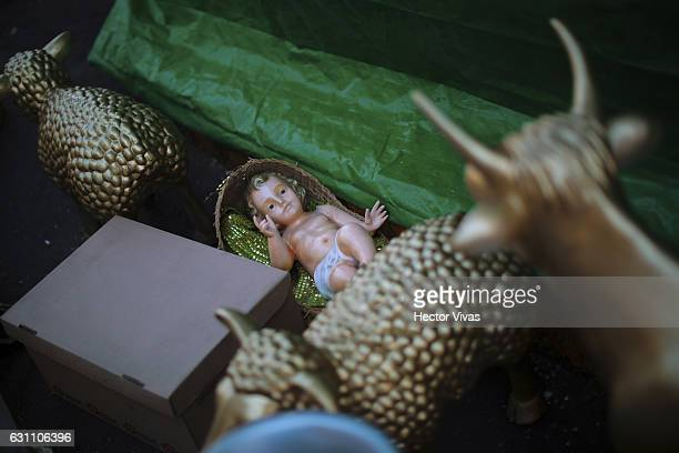 A figure of the baby Jesus is in the street while decorating the stands of the three Wise Man during the Three Wise Man celebration on January 06...