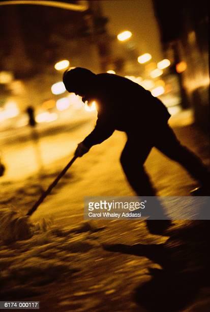 Figure Shovelling Snow