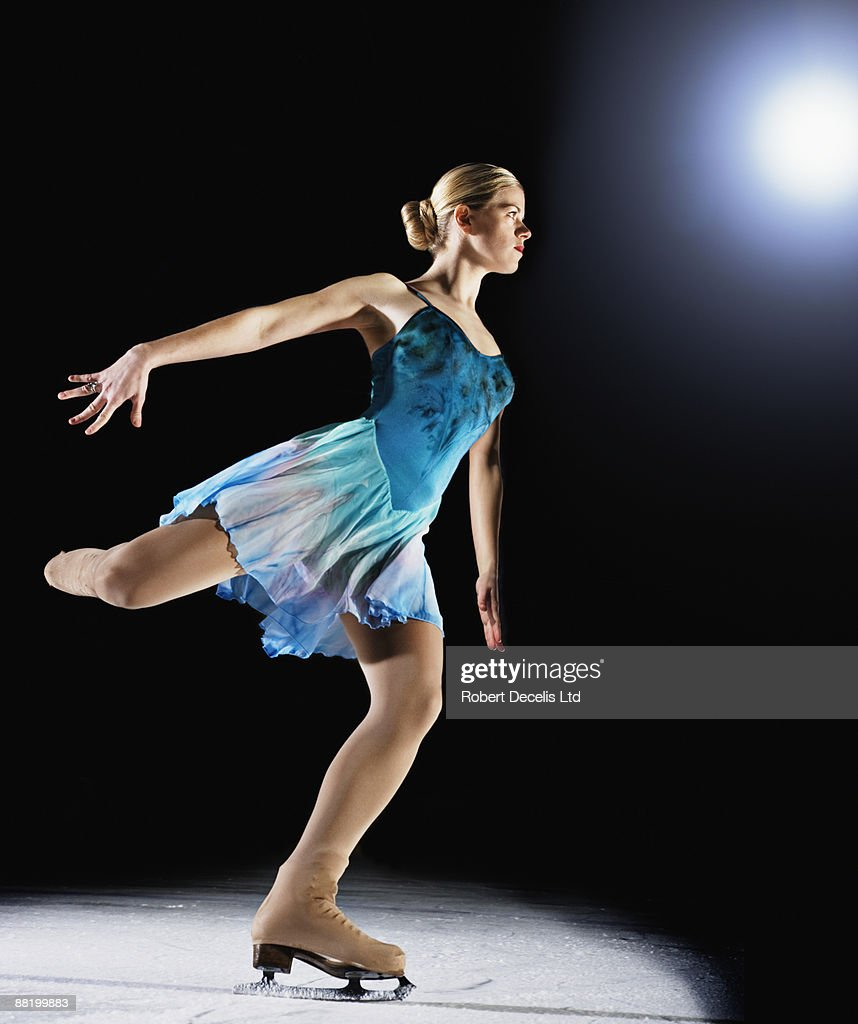 Figure skater about to perform jump.