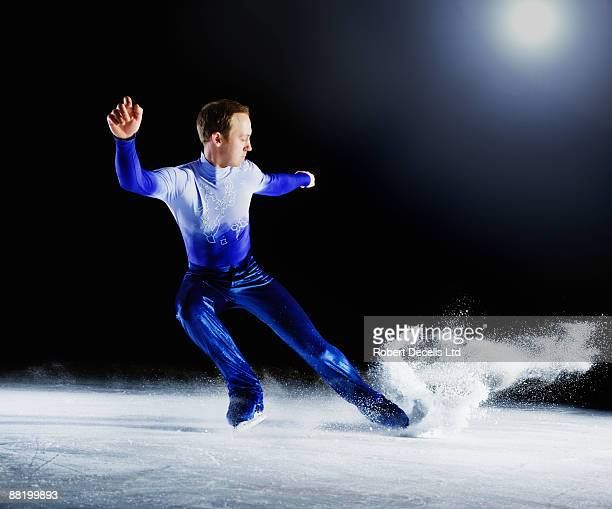 Figure skater creating spray of ice.