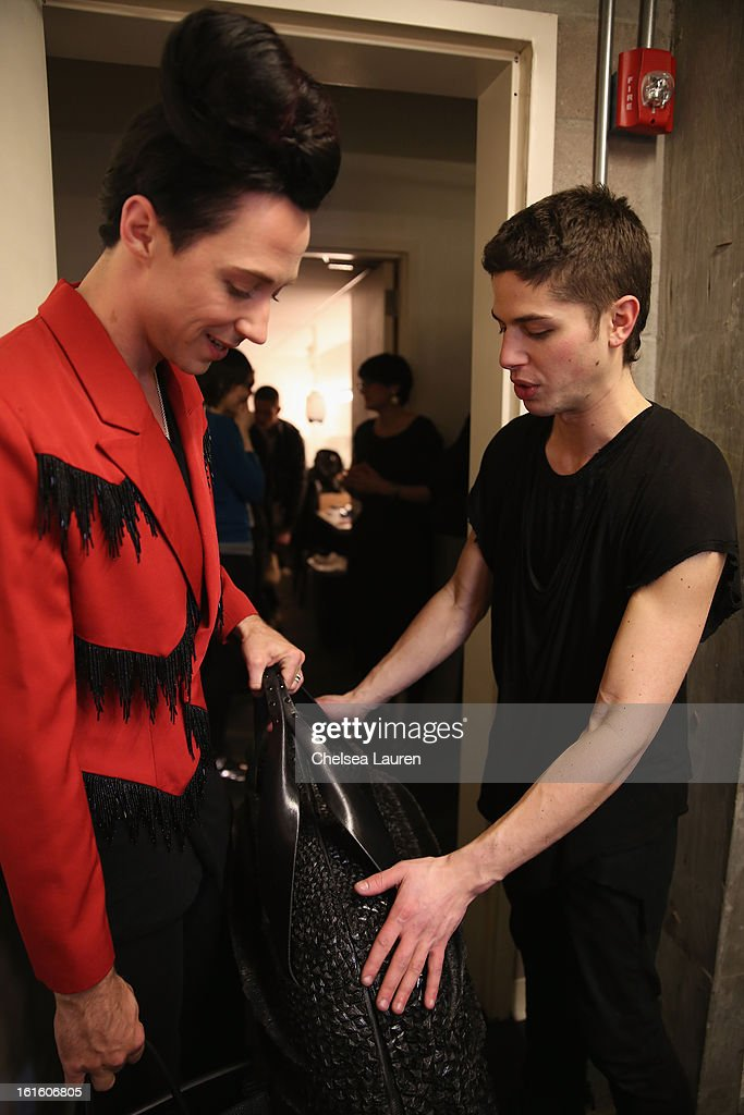 Figure skater Johnny Weir and Asher Levine attend the Asher Levine Fall 2013 fashion show during Mercedes-Benz Fashion Week at at Manhattan Movement & Arts Center on February 12, 2013 in New York City.