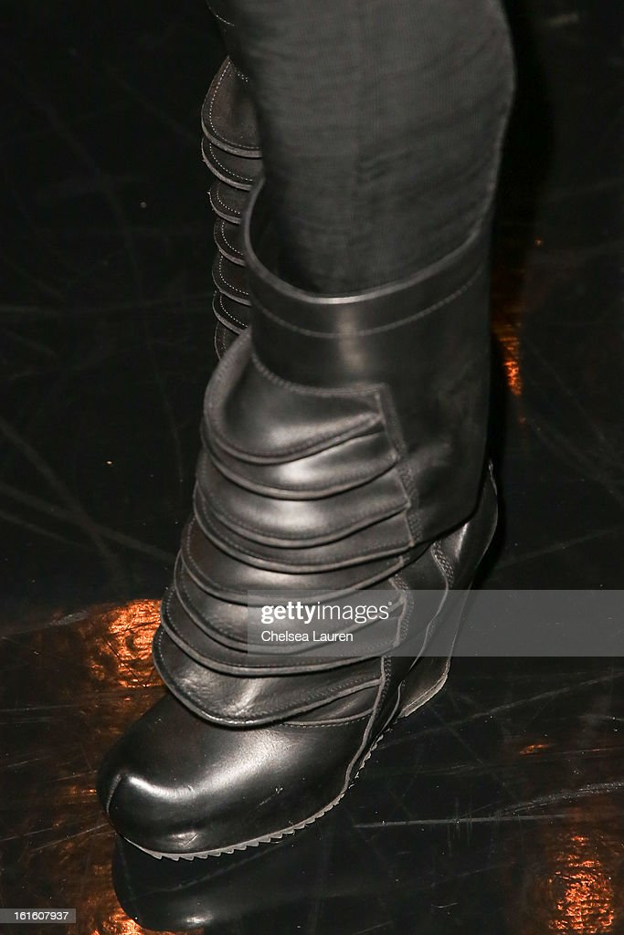 Figure skater <a gi-track='captionPersonalityLinkClicked' href=/galleries/search?phrase=Johnny+Weir&family=editorial&specificpeople=208701 ng-click='$event.stopPropagation()'>Johnny Weir</a> (shoe detail) attends the Asher Levine F/W 2013 runway show at Manhattan Movement & Arts Center on February 12, 2013 in New York City.