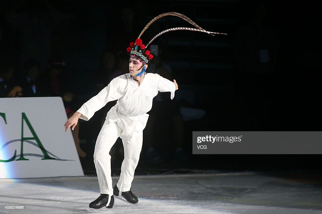 Figure Skater <a gi-track='captionPersonalityLinkClicked' href=/galleries/search?phrase=Johnny+Weir&family=editorial&specificpeople=208701 ng-click='$event.stopPropagation()'>Johnny Weir</a> performs during Artistry On Ice 2014 at Guangzhou international sports and entertainment center on August 1, 2014 in Guangzhou, China.
