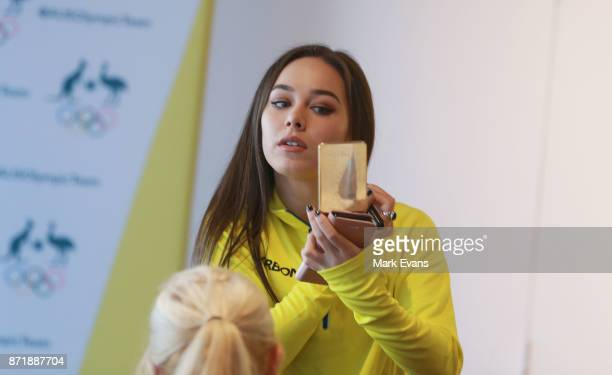 Figure skater Kailani Craine checks herself in the mirror before the Australia Winter Olympic Athlete Announcement at Museum of Contemporary Art on...