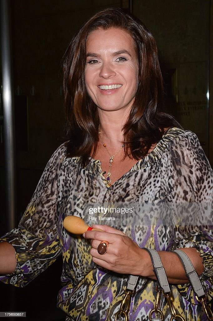 Figure skater <a gi-track='captionPersonalityLinkClicked' href=/galleries/search?phrase=Katarina+Witt&family=editorial&specificpeople=203221 ng-click='$event.stopPropagation()'>Katarina Witt</a> leaves the Sirius XM studios on August 5, 2013 in New York City.