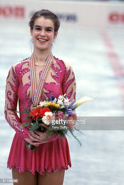Figure skater Katarina Witt of East Germany poses with her Gold medal during the 1984 World Championships in Ottawa Canada Katarina Witt is a...