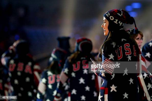Figure skater Madison Chock enters the stadium with the United States Olympic team during the Opening Ceremony of the Sochi 2014 Winter Olympics at...