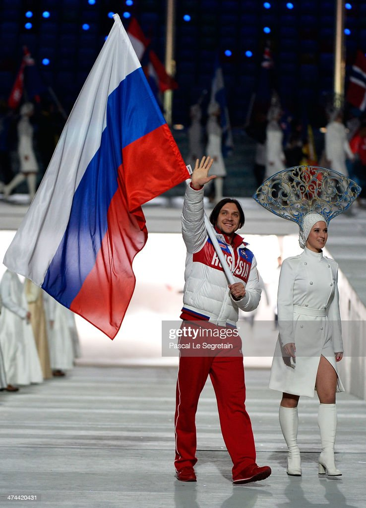 Figure skater <a gi-track='captionPersonalityLinkClicked' href=/galleries/search?phrase=Maxim+Trankov&family=editorial&specificpeople=798054 ng-click='$event.stopPropagation()'>Maxim Trankov</a> of Russia enters with the flag during the 2014 Sochi Winter Olympics Closing Ceremony at Fisht Olympic Stadium on February 23, 2014 in Sochi, Russia.