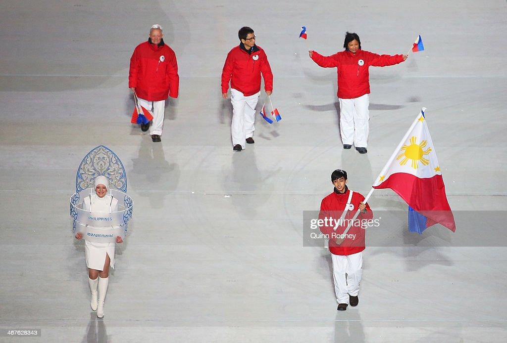 Figure skater Michael Christian Martinez of the Philippines Olympic team carries his country's flag during the Opening Ceremony of the Sochi 2014...