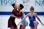 US figure skater Michelle Kwan and Chinese skater Lu Chen hug during the medals ceremony in White Ring at the 1998 Winter Olympic games