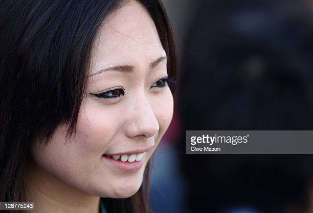Figure skater Miki Ando is seen in the paddock before qualifying for the Japanese Formula One Grand Prix at Suzuka Circuit on October 8 2011 in...
