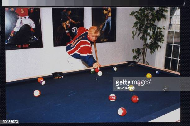 Figure skater Nicole Bobek making a shot at pool table in clubhouse at her apartment complex