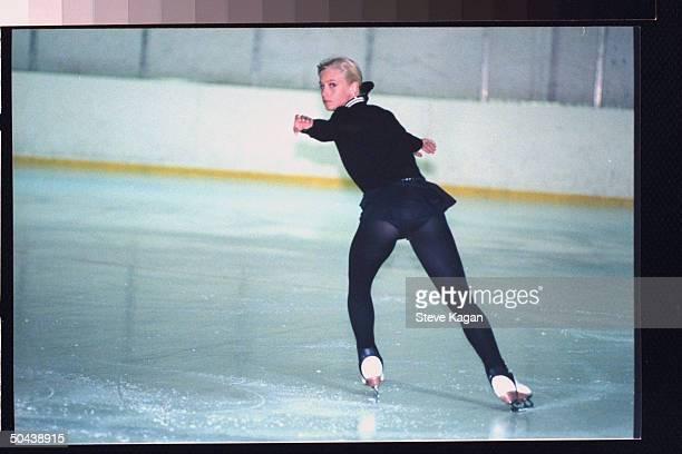 Figure skater Nicole Bobek practicing on ice rink