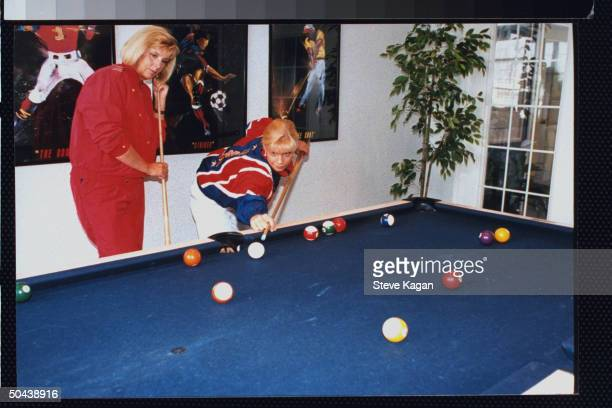 Figure skater Nicole Bobek shooting pool w mother Jana in clubhouse of their apartment complex