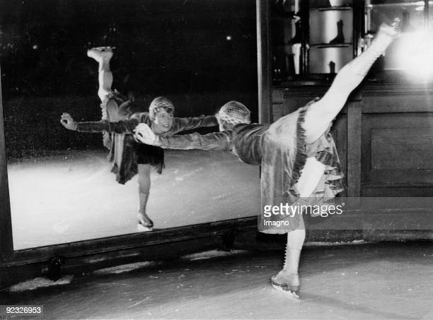 Figure skater practicing watching herself in the mirror Photograph England Around 1935