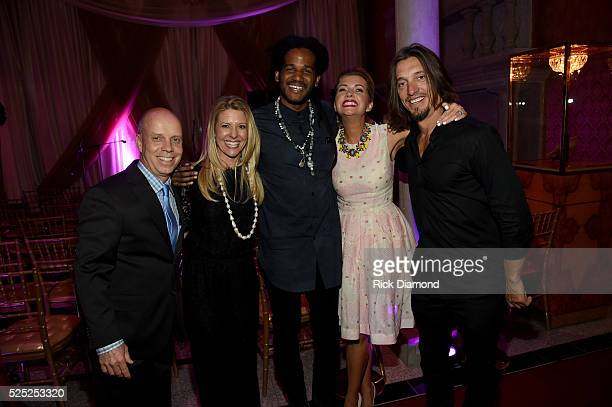 Figure skater Scott Hamilton Tracie Hamilton of J/P Haitian Relief Organization musical artist Paul Beaubrun actress Susan Yeagley and guitarist Brad...