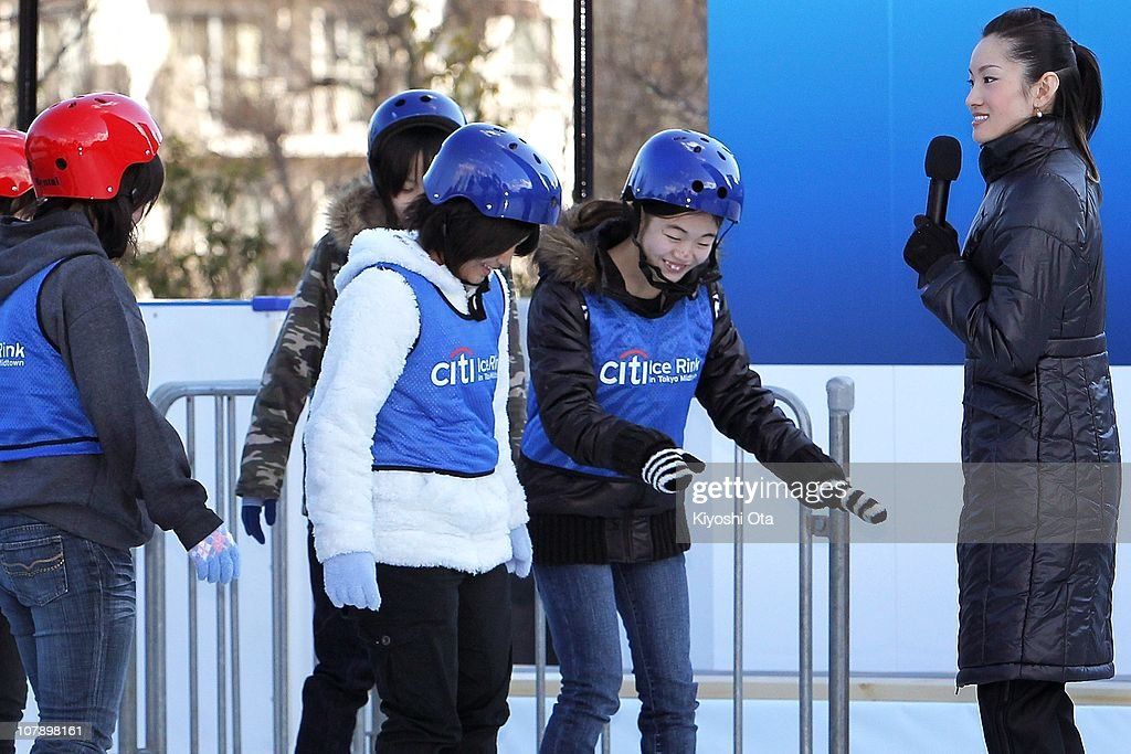 Figure skater Shizuka Arakawa, the 2006 Turin Winter Olympics figure skating gold medalist, teaches ice skating to children after the opening ceremony for the Citi Ice Rink at Tokyo Midtown on January 6, 2011 in Tokyo, Japan. The outdoor ice skating rink will open between January 7 and February 28.