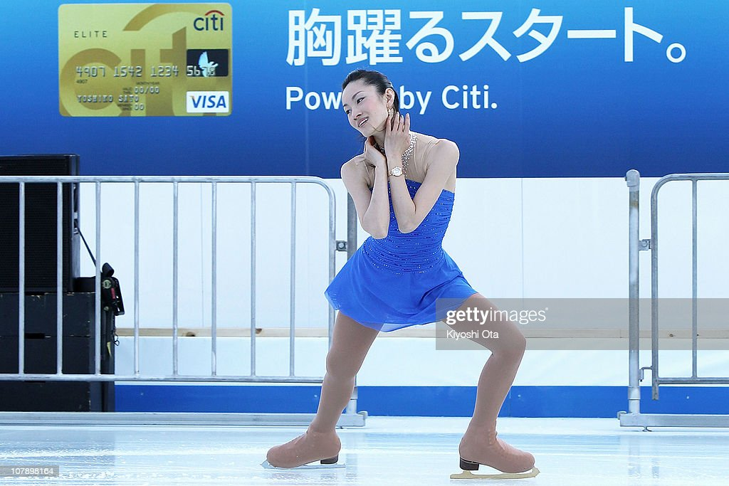 Figure skater <a gi-track='captionPersonalityLinkClicked' href=/galleries/search?phrase=Shizuka+Arakawa&family=editorial&specificpeople=215456 ng-click='$event.stopPropagation()'>Shizuka Arakawa</a>, the 2006 Turin Winter Olympics figure skating gold medalist, performs during the opening ceremony for the Citi Ice Rink at Tokyo Midtown on January 6, 2011 in Tokyo, Japan. The outdoor ice skating rink will open between January 7 and February 28.