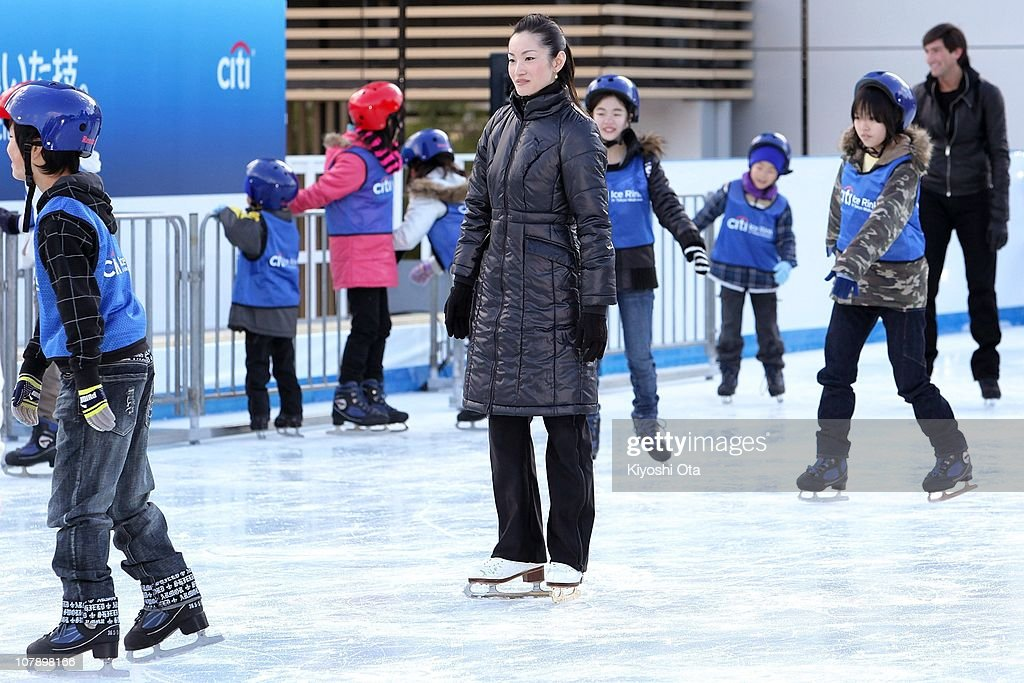 Figure skater <a gi-track='captionPersonalityLinkClicked' href=/galleries/search?phrase=Shizuka+Arakawa&family=editorial&specificpeople=215456 ng-click='$event.stopPropagation()'>Shizuka Arakawa</a>, the 2006 Turin Winter Olympics figure skating gold medalist, teaches ice skating to children after the opening ceremony for the Citi Ice Rink at Tokyo Midtown on January 6, 2011 in Tokyo, Japan. The outdoor ice skating rink will open between January 7 and February 28.