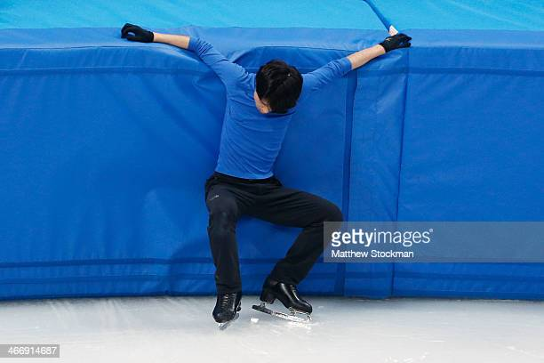 Figure skater Tatsuki Machida of Japan stands up after falling during a training session ahead of the Sochi 2014 Winter Olympics at the Iceberg...