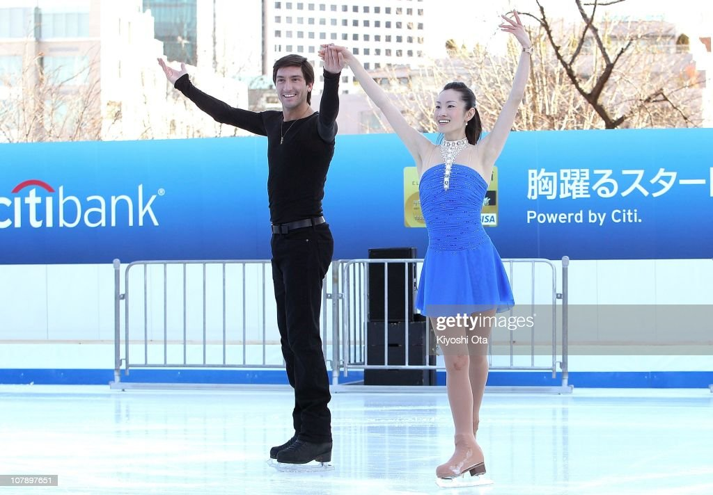 Figure skaters Evan Lysacek (L) of the United States, the 2010 Vancouver Winter Olympics figure skating gold medalist, and Shizuka Arakawa, the 2006 Turin Winter Olympics figure skating gold medalist, greet the audience after their performance during the opening ceremony for the Citi Ice Rink at Tokyo Midtown on January 6, 2011 in Tokyo, Japan. The outdoor ice skating rink will open between January 7 and February 28.