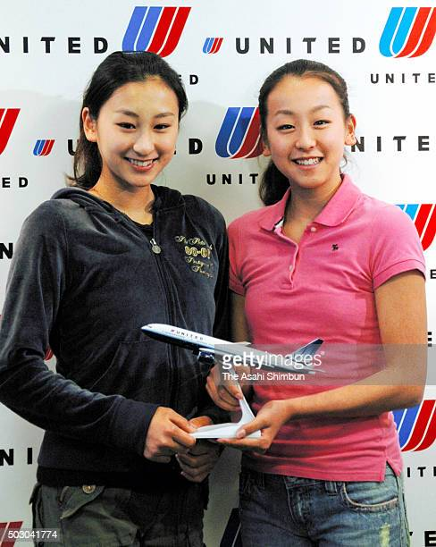 Figure skaters Mai Asada and younger sister Mao Asada pose for photographs during a press conference at Narita International Airport on August 28...