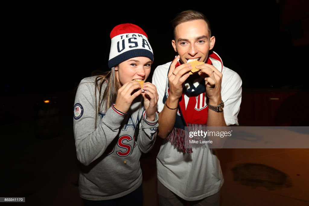 Figure skaters Mariah Bell and Adam Rippon make smores during the Team USA Media Summit opening reception at the Red Pine Lodge on September 24, 2017 in Park City, Utah.