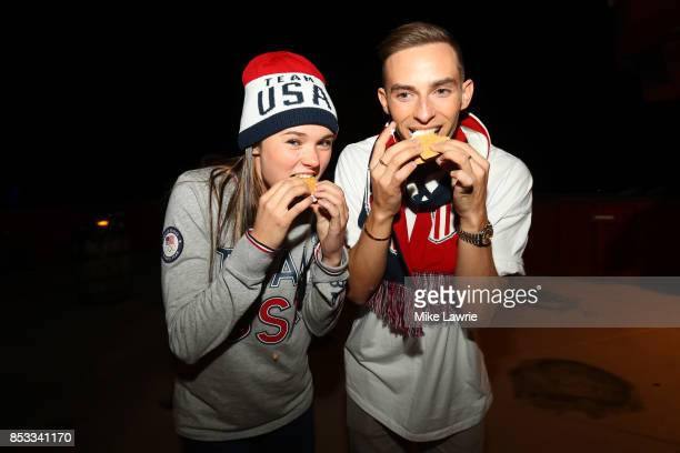 Figure skaters Mariah Bell and Adam Rippon make smores during the Team USA Media Summit opening reception at the Red Pine Lodge on September 24 2017...