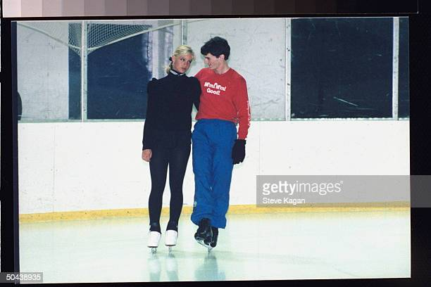 Figure skaters Nicole Bobek Todd Eldredge lazily skating arminarm on practice rink Bobek was brought up on charges of unlawful entry when caught in...