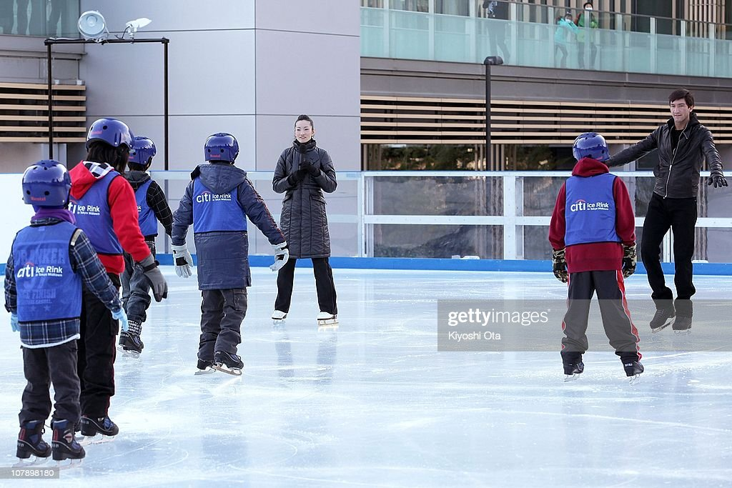 Figure skaters Shizuka Arakawa, the 2006 Turin Winter Olympics figure skating gold medalist, and Evan Lysacek (R) of the United States, the 2010 Vancouver Winter Olympics figure skating gold medalist, teach ice skating to children after the opening ceremony for the Citi Ice Rink at Tokyo Midtown on January 6, 2011 in Tokyo, Japan. The outdoor ice skating rink will open between January 7 and February 28.