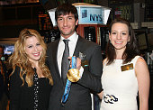 US Figure Skaters Tara Lipinski Evan Lysacek and Sarah Hughes ring the NYSE closing bell to mark the 50th anniversary of the plane crash that killed...