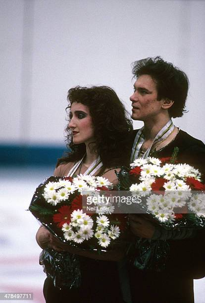 1992 Winter Olympics Unified Team Marina Klimova and Sergey Ponomarenko victorious with medals and flowers after winning gold during Mixed Ice...