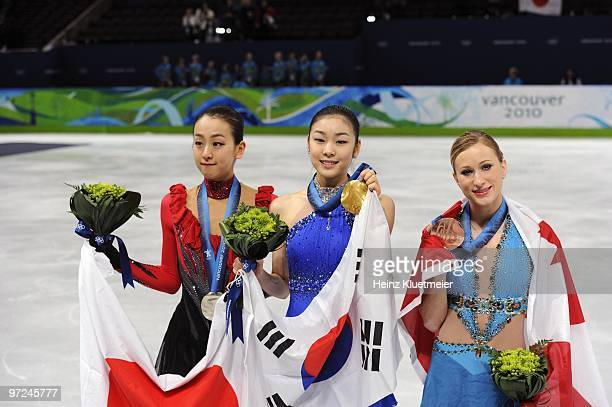 2010 Winter Olympics Japan Asada Mao South Korea Kim YuNa and Canada Joannie Rochette victorious with flags and medals after winning Women's Free...