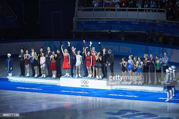 2014 Winter Olympics View of Team Canada Team Russia and Team USA victorious on medal stand after Team Ice Dance Free Dance at Iceberg Skating Palace...