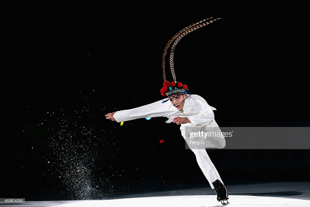 Figure skating champions Johnny Weir performs as he dresses in Peking Opera's female costume during Artistry On Ice 2014 on July 25, 2014 in Beijing, China.