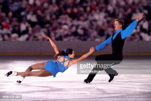 Figure skating pair performing in front of crowd (Digital Composite) : Stock Photo