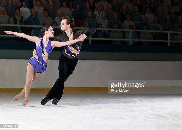 Figure skating pair skating side-by-side in the Killian Position