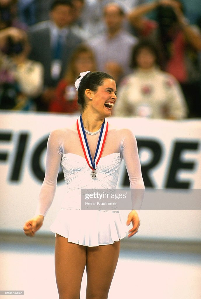 Nancy Kerrigan victorious wearing silver medal after competition at Orlando Arena. Heinz Kluetmeier X42277 )
